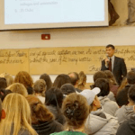 Dean of Students talks to students at orientation